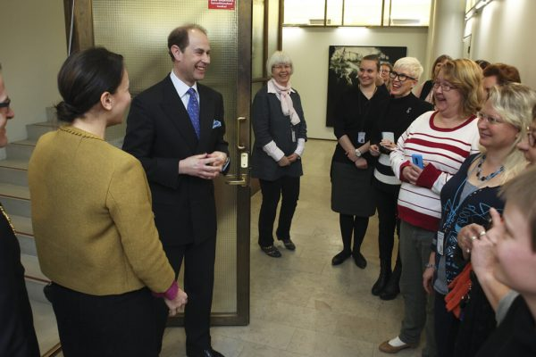 Prince Edward has just stepped into the corridor of the City Hall register office, where a group of smiling City Hall employees are waiting to welcome him.